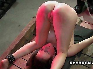 Slave babe in bondage gets spanked and toyed