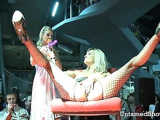 Horny slut spreading her legs at the sex show