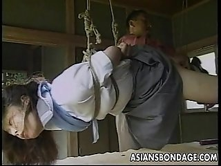 Sexy little Asian girl gets tied up and teased by her partner